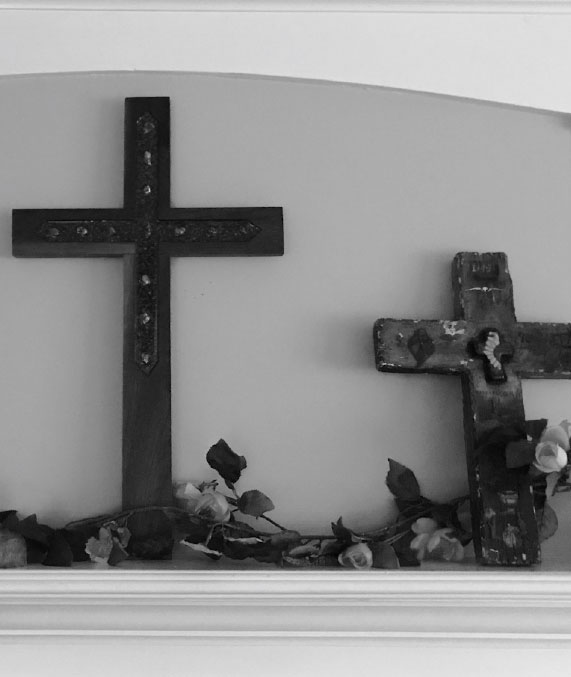 Crosses leaning against wall